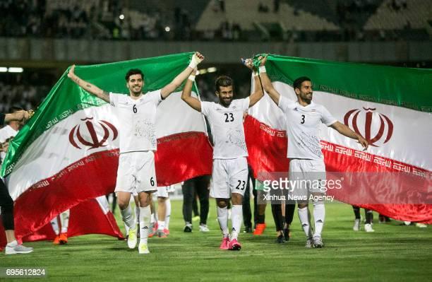 TEHRAN June 12 2017 Saeid Ezzatollahi Ramin Rezaeian Ehsan Hajsafi of Iran celebrate after the FIFA World Cup 2018 Asian qualification soccer match...
