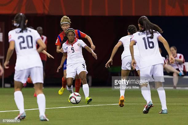 Costa Rica defender Diana Saenz controls the ball as Korea midfielder Kang Yumi defends during the 2015 FIFA Women's World Cup Group E match between...