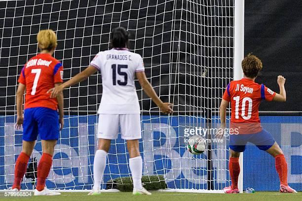 Korea forward Ji Soyun scores a goal against Costa Rica goalkeeper Dinnia Diaz during the 2015 FIFA Women's World Cup Group E match between Korea and...