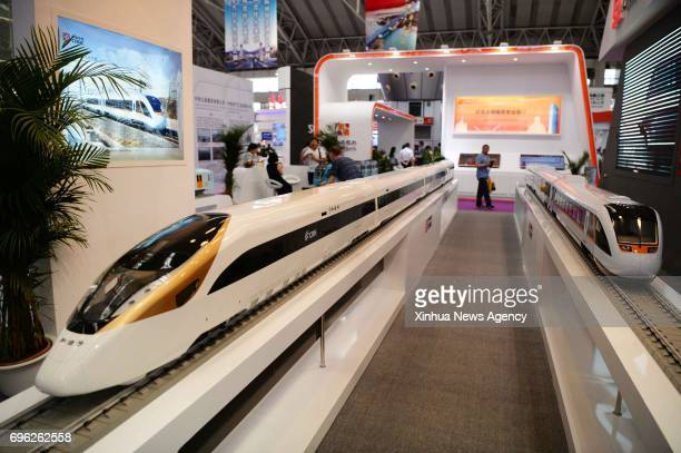 Highspeed train models are displayed at the 4th ChinaRussia Expo held in Harbin capital of northeast China's Heilongjiang Province June 15 2017 Over...