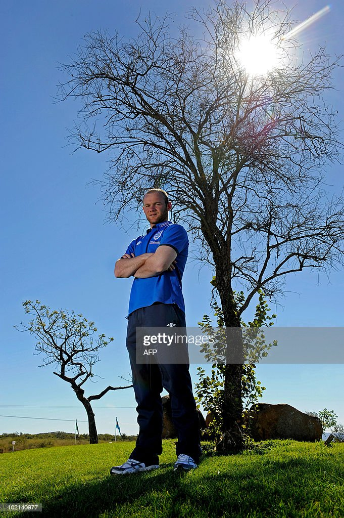 June 16, 2010 at 2200 GMT - RESTRICTION APPLIES TO ALL MEDIA INCLUDING WEBSITE Wayne Rooney poses for a photograph after an England press conference at the Royal Bafokeng Sports Campus on June 16, 2010 in Rustenburg, South Africa. AFP PHOTO/POOL/Michael Regan ATTENTION - EMBARGO, RELEASABLE June 16, 2010 at 2200 GMT - RESTRICTION