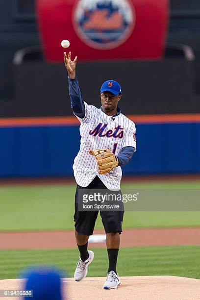 NY Giants first round draft pick Eli Apple throws out a ceremonial first pitch prior to the start of a regular season game between the Pittsburgh...