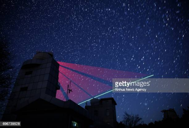 HEFEI June 16 2017 Composite photo taken on Nov 9 2016 shows a satellitetoearth link established between quantum satellite 'Micius' and the quantum...