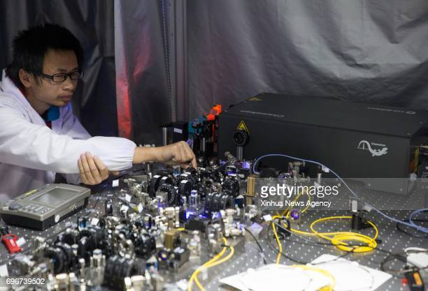 HEFEI June 16 2017 Photo taken on Dec 9 2016 shows a scientist working at a quantum communication ground station in southwest China's Tibet...
