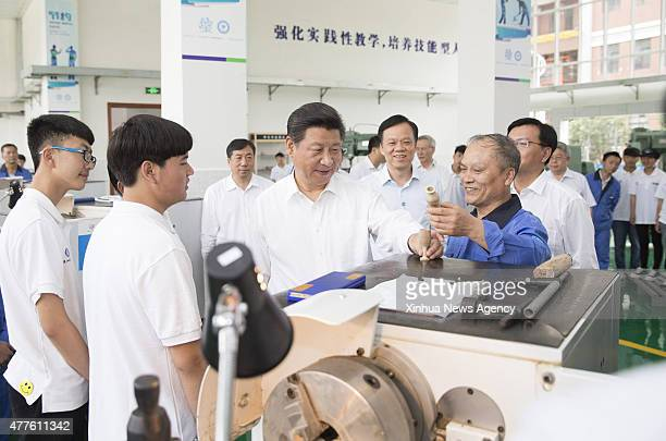GUIYANG June 17 2015 Chinese President Xi Jinping [3rd L front] visits Guizhou Machinery Industry School a vocational college in Guiyang capital of...