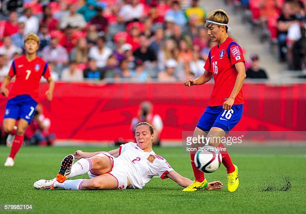 Defender Cecila Jimenez of Spain executes a perfectly timed sliding tackle on Kang Yumi of Korea Republic during the FIFA 2015 Women's World Cup...