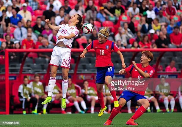 Irene Paredes of Spain and Kang Yumi of Korea Republic compete for the ball as Park Eunsun of Korea Republic watches on during the FIFA 2015 Women's...