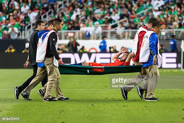 Chile midfielder Francisco Silva carried off during the second half of the Copa Centenario quarter final match between Mexico and Chile held at...