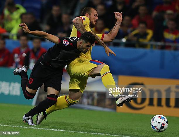 LYON June 19 2016 Elseid Hysaj left of Albania vies with Denis Alibec of Romania during the Euro 2016 group A soccer match between Romania and...