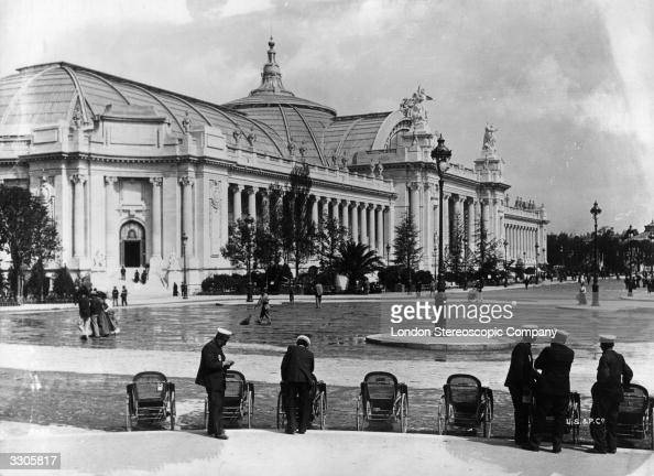 General view of the Grand Palais built for the Paris Exhibition 1900 with bath chairs and attendants in the foreground