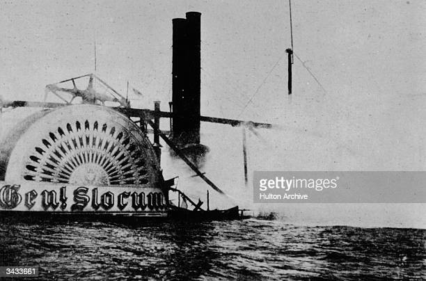 The stricken steamship General Slocum which caught fire during a pleasure cruise on New York City's East River resulting in the loss of over 1100...