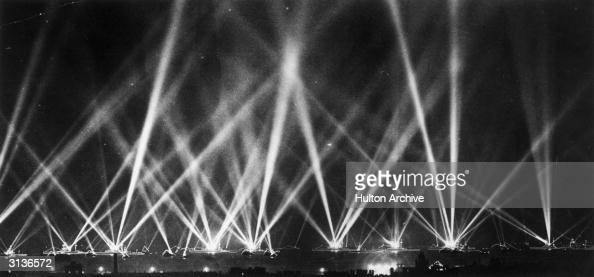 Searchlights fill the sky as the fleet is illuminated during the Coronation review of King George V