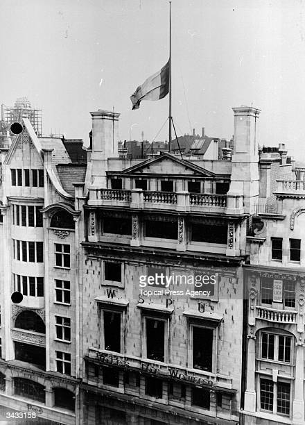 The Suffragette flag at half mast over the headquarters of the Women's Social and Political Union at Lincoln's Inn House Kingsway London after the...
