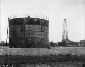 Storage tank and derrick at AngloMexican oil wells in Chesterfield Derbyshire