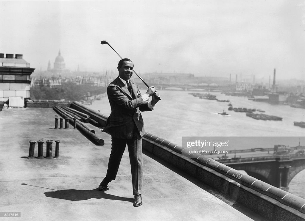 American golfer Walter Hagen practising his swing on the roof of the Savoy Hotel in London