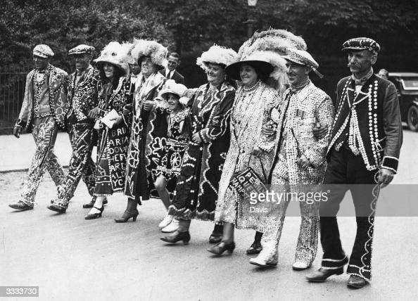 A line of Pearly Kings and Queens arriving at the annual Costers Donkey and Pony Show in Regents Park