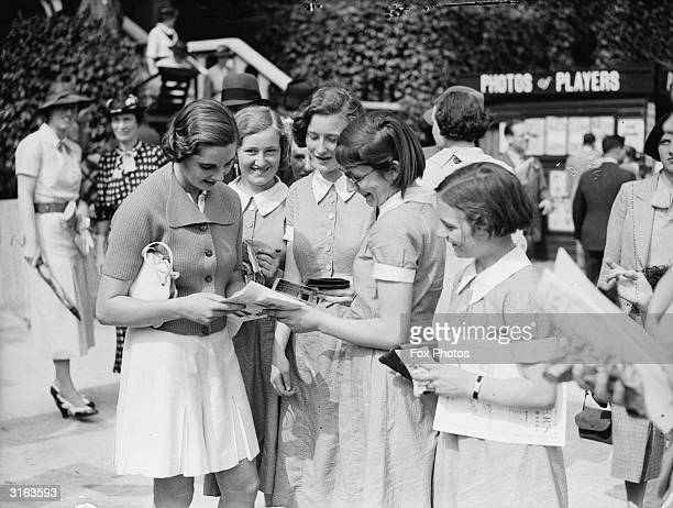 British tennis player Kay Stammers signing autographs for eager young tennis fans at Wimbledon in southwest London