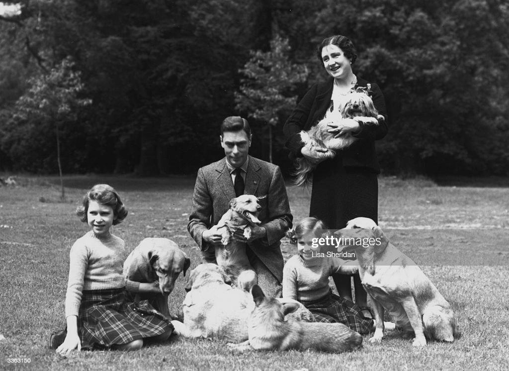 King George VI (1895 - 1952) and Queen Elizabeth with Princesses Margaret Rose (1930 - 2002) and Elizabeth (left) in the grounds of Windsor Castle, Berkshire.