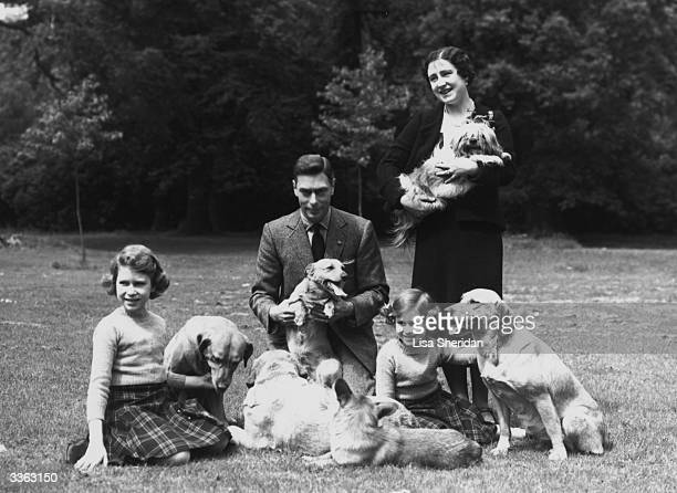 King George VI and Queen Elizabeth with Princesses Margaret Rose and Elizabeth in the grounds of Windsor Castle Berkshire