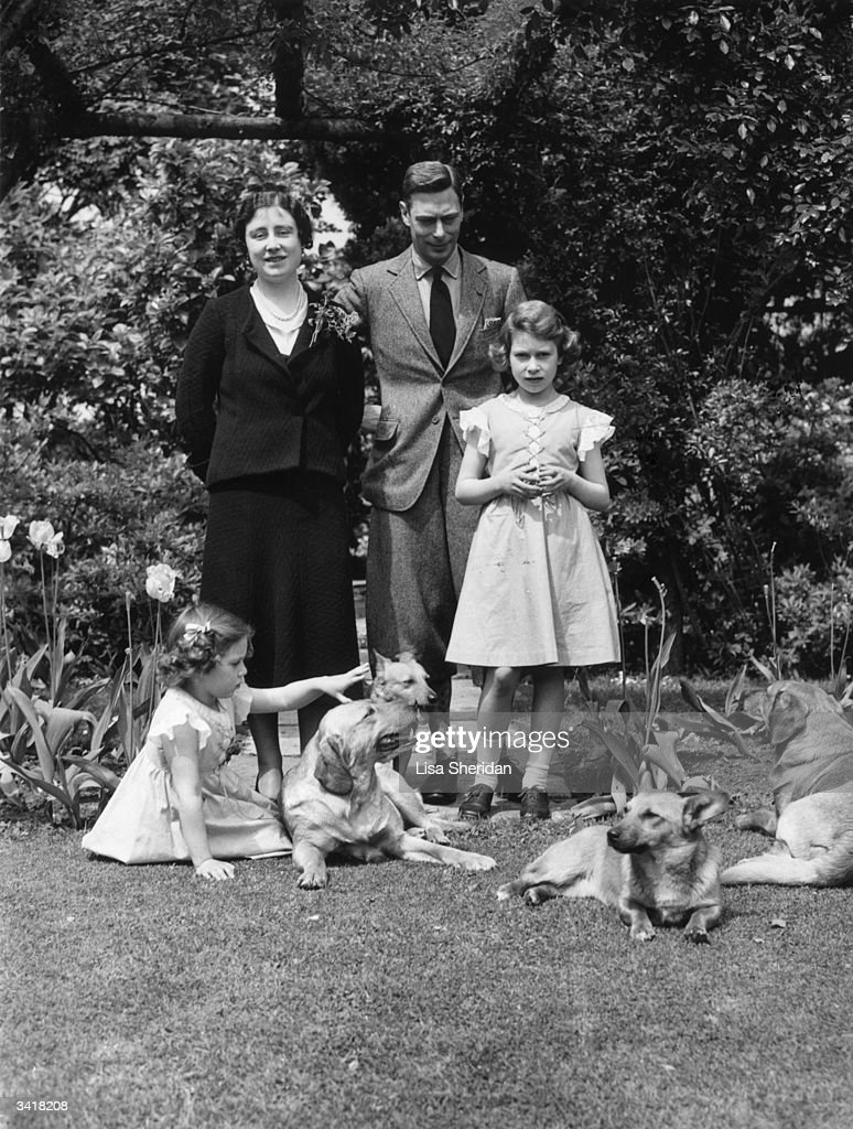 The Royal family with their dogs in the grounds of the Royal Lodge Windsor Queen Elizabeth Queen Consort to King George VI King George VI Princess...