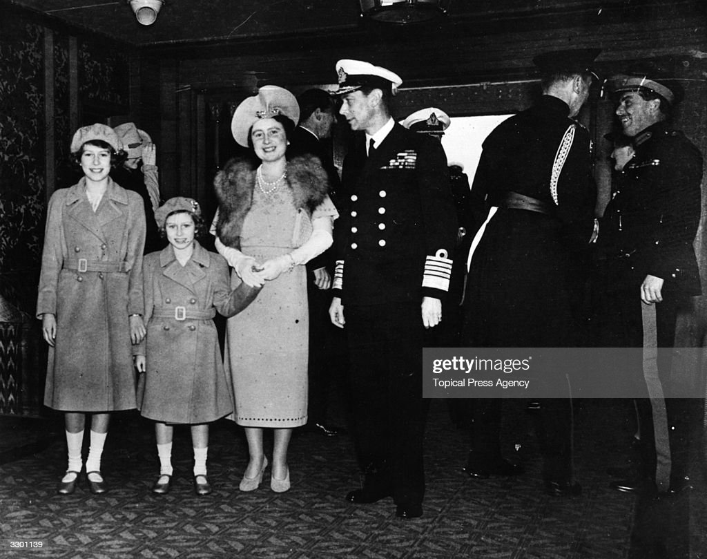King George VI (1895 -1952) and Queen Elizabeth reunited with their daughters, Princesses Elizabeth (left) and Margaret Rose (1930 - 2002) on board the 'Empress of Britain' after a world tour.