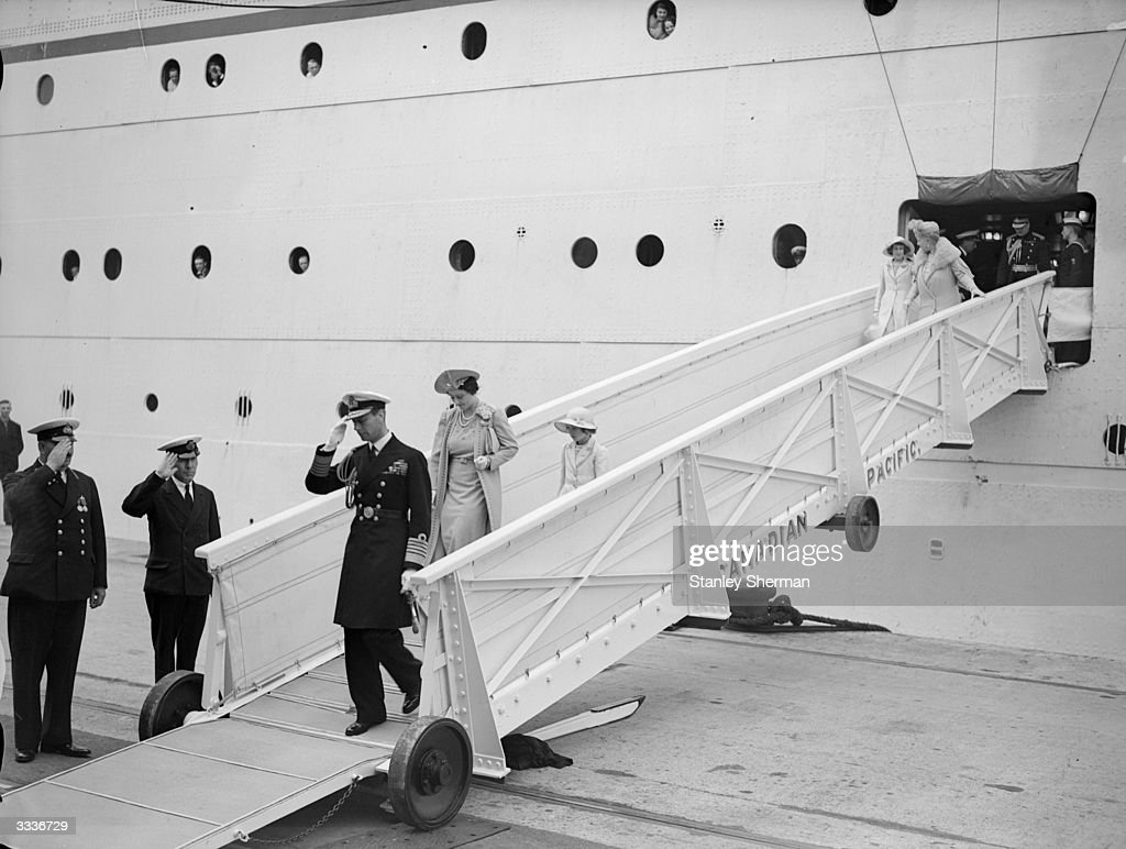 King George VI (1895 - 1952) and the Queen, Lady Elizabeth Bowes-Lyon (1900 - 2002), descending the gangway of the liner 'Empress of Britain' at Southampton.