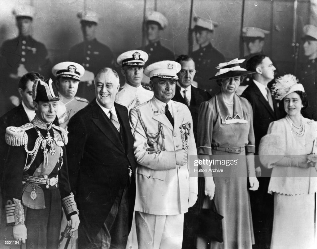 King George VI of Great Britain (1895 - 1952) (left) with American President, Franklin Delano Roosevelt (1882 - 1945), his aide, Brigadier General Watson, (centre), American social activist, Eleanor Roosevelt and Queen Elizabeth (1900 - 2002, right).