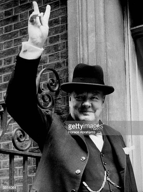 British Prime Minister Winston Churchill gives the 'V' sign outside No 10 Downing Street London