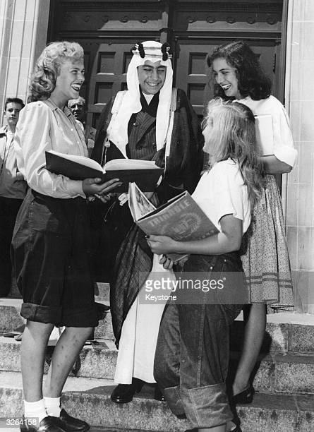 Nawaf Ibn Abdul Aziz son of Abdul Aziz Ibn Saud King Of Saudi Arabia at 14 years talking to girl students on the steps of the Bayside High School at...