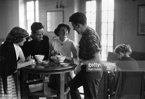 British students Janet Snell and Vera Kaden from St Andrew's University studying French at the Sorbonne Paris chat with friends over a cup of coffee...