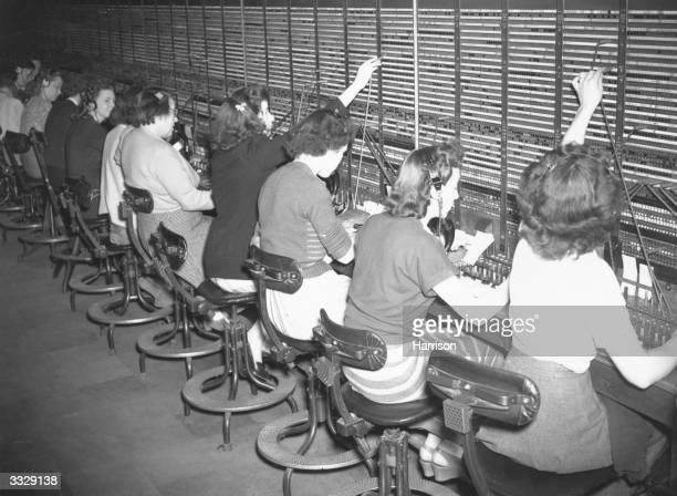 Operators connecting calls through the switchboard in one of the Continental English speaking sections at the Trunk Continental and Toll Exchanges of...