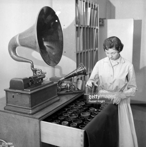 Librarian Shirley Vennell with the huge wooden horn of Edison's cylinder phonograph and a small Berliner machine at the BBC Record Library in London
