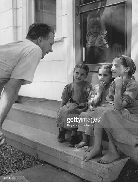 Amish children talk to a visitor outside their home in Lancaster Pennsylvania