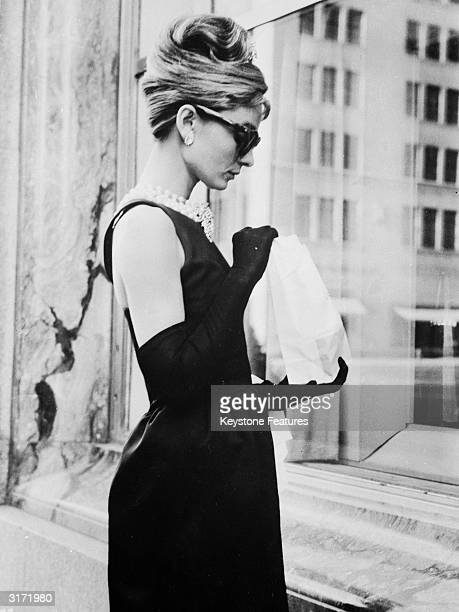Audrey Hepburn stops for lunch on Fifth Avenue in New York during location filming for 'Breakfast At Tiffany's' directed by Blake Edwards in which...