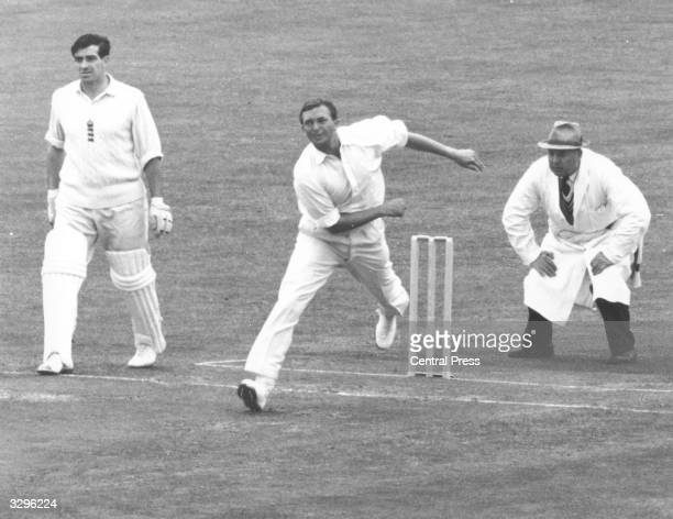 Richie Benaud of Australia is watched very carefully by the umpire as he bowls on the first day of the first England v Australia test match at...
