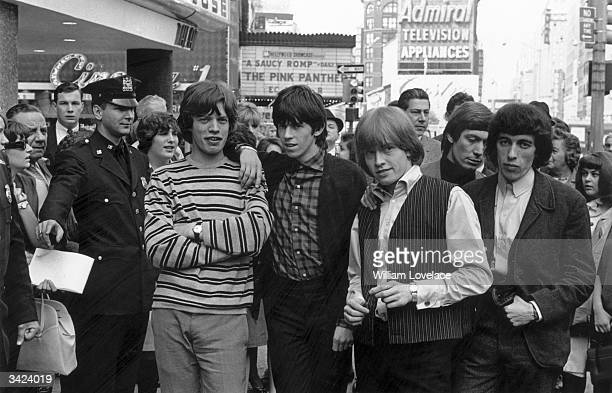 From left to right Mick Jagger Keith Richards Brian Jones Charlie Watts and Bill Wyman of the Rolling Stones pose for a photo in a New York street...