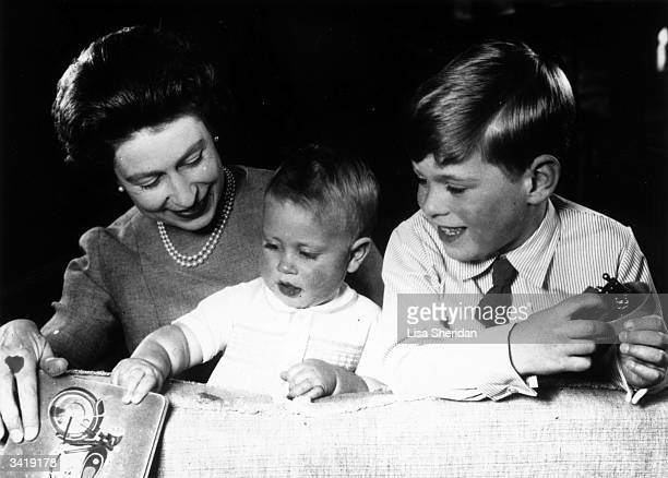 Queen Elizabeth II plays with Princes Edward and Andrew at Windsor Castle