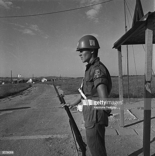 A United Nations Emergency Force officer manning a checkpoint on the border between Gaza and Israel