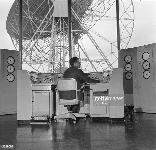 An astronomer operating the giant Mark I radio telescope from the control room at Jodrell Bank Observatory near Macclesfield in Cheshire