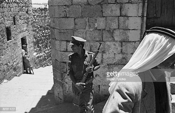 Armed patrols on the narrow walled streets of Jerusalem during the Arab Israeli Six Day War