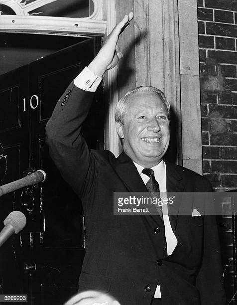 The Prime Minister Edward Heath giving a victory wave as he arrives at 10 Downing Street after receiving his seal of office from the Queen