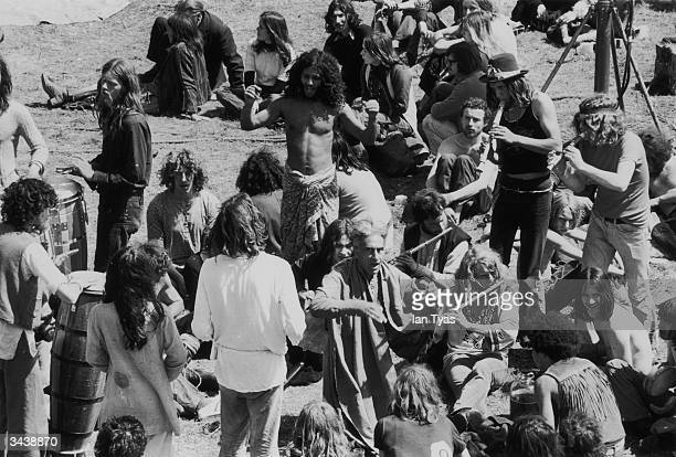 Hippies at the second annual Glastonbury festival celebrating the summer solstice with dancing and music