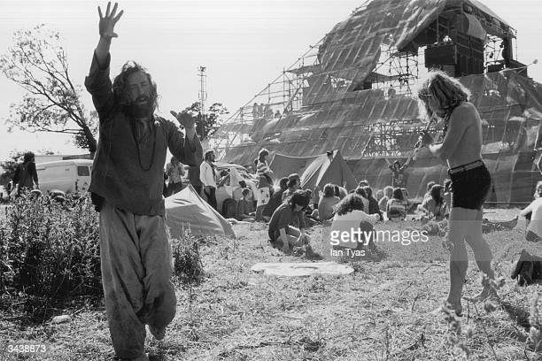 Hippies at the second Glastonbury Festival celebrate the summer solstice with music and dancing