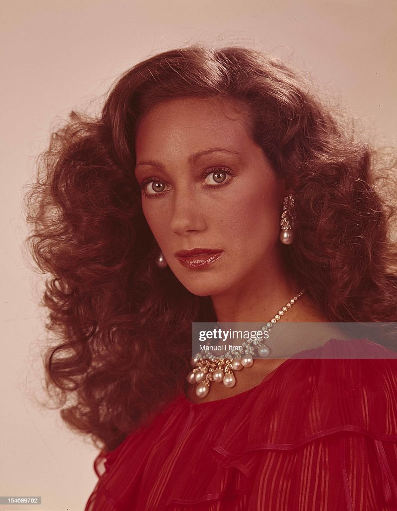 June 1977 studio portrait of the actress Marisa Berenson, wearing a necklace and pearl earrings.