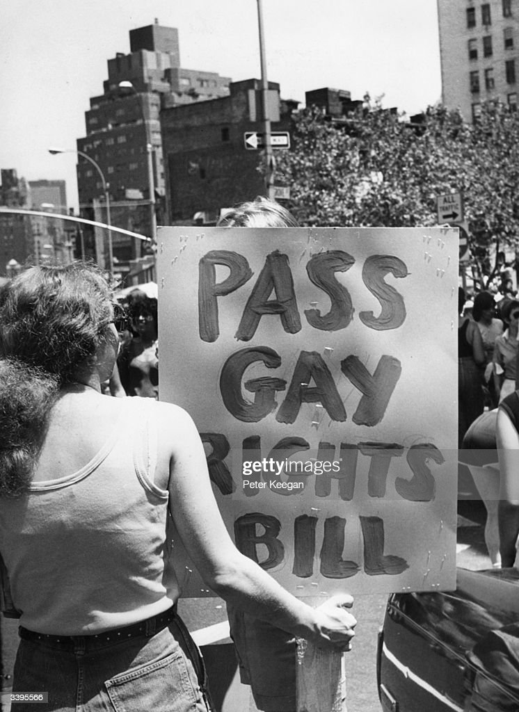 A marcher in New York carrying a banner demanding that the Gay Rights Bill which guarantees homosexuals equal rights in employment housing and public...