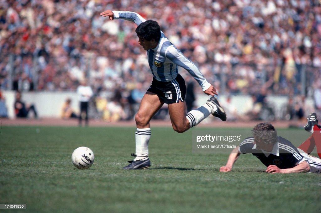 02 June 1979 International football Scotland v Argentina Diego Maradona keeps his balance as he takes the ball past the fallen Paul Hegarty