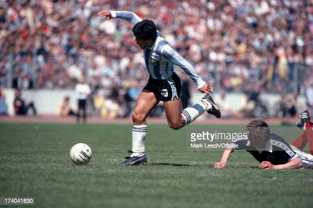 02 June 1979 International football Scotland v Argentina Diego Maradona keeps his balance as he takes the ball past the fallen Paul Hegarty