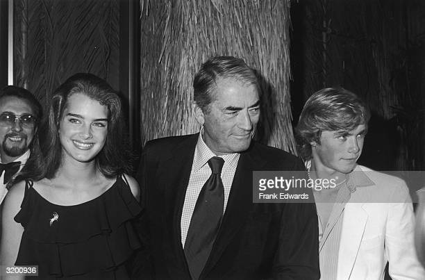 American actors Brooke Shields Gregory Peck and Christopher Atkins at the Hollywood premiere of director Randal Kleiser's film 'The Blue Lagoon'...