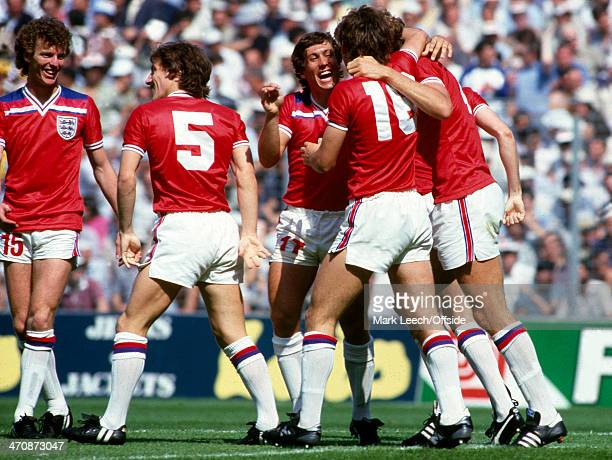 16 June 1982 FIFA World Cup England v France Graham Rix Steve Coppell and Kenny Sansom celebrate teammate Bryan Robson's early goal