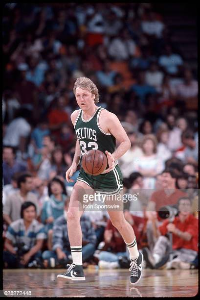 Larry Bird of the Boston Celtics dribbles up court versus the Los Angeles Lakers at the Forum in Inglewood CA